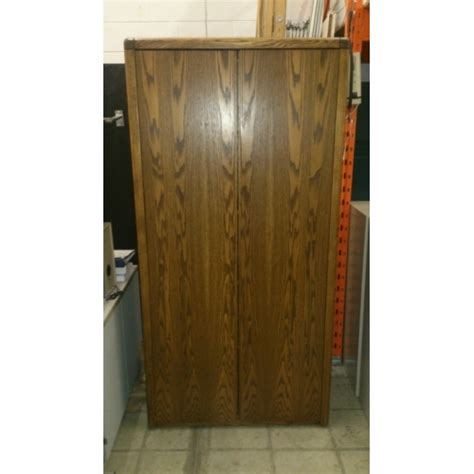 wood  door enclosed storage cabinet  shelves bull