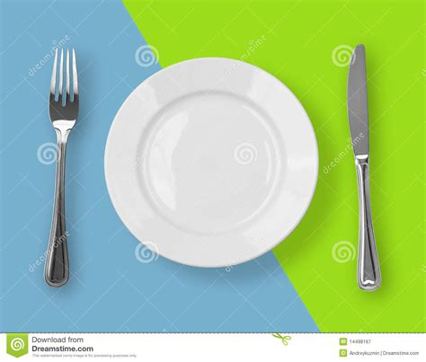 knife plate  fork  color backdrop top view royalty
