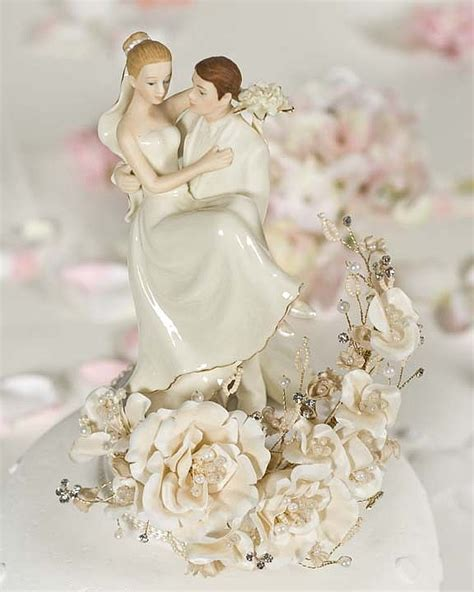 vintage groom holding bride wedding cake topper wedding