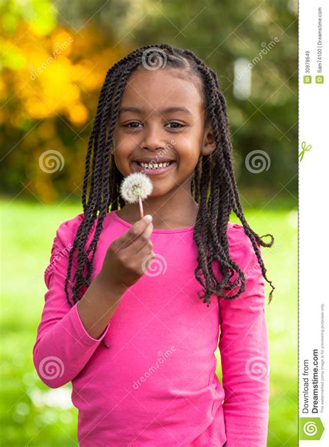 Outdoor Portrait Of A Cute Young Black Girl African