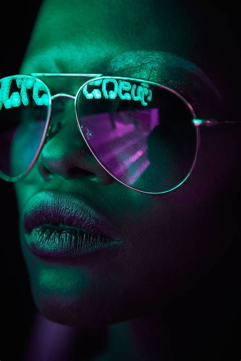 pop portraits  neon light reflected  sunglasses