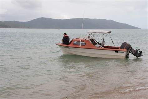 Small Fishing Boat Anchors by Anchoring A Small Boat While Cing Onshore 100 Magic