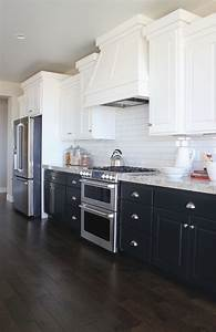 having a moment navy and white kitchen cabinets lauren With best brand of paint for kitchen cabinets with paris wall art black and white