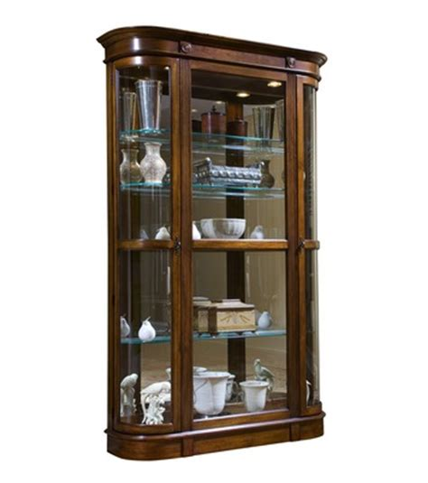 pulaski curved glass curio cabinet curved end curio cabinet in salerno brown closeout by