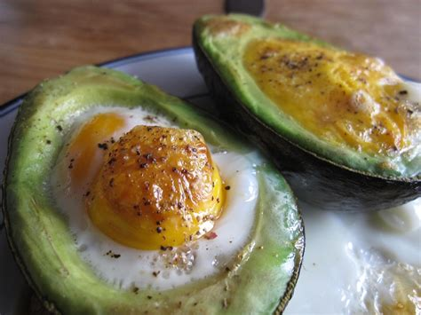 cooked avocado baked egg in avocado nothemingway