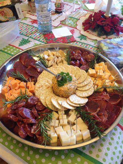 christmas meat cheese  cracker tray rosemary garnish