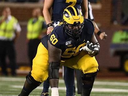 Onwenu Michigan Michael Riley Rueben Football Praises