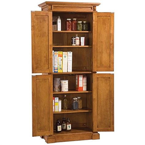 oak pantry cabinets kitchen home styles 5004 69 americana pantry storage cabinet 3585