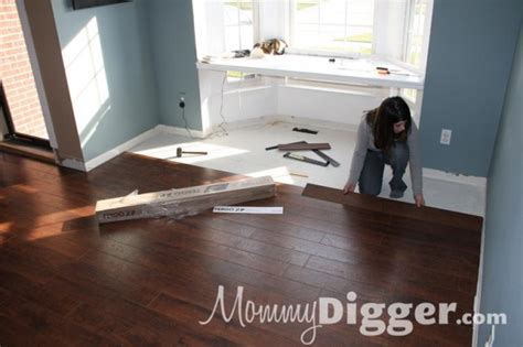 pergo xp flooring installation our living room renovation installing pergo xp flooring diy project mommy digger
