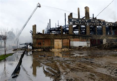 massive fire destroys  michigan woodworking plant