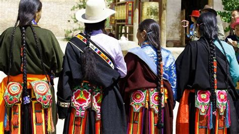 the essence of tibetan culture seen through the attire and accessories they adorn