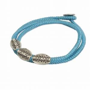 Light blue cord wrap bracelet with silver pendants