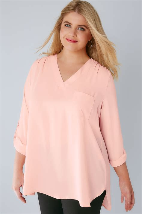 blush blouse blush pink v neck blouse with roll up sleeves pocket