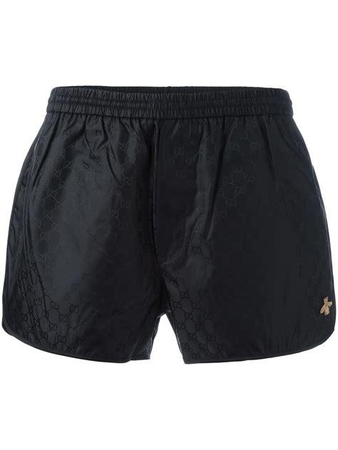 gucci synthetic gg swim shorts black men lyst