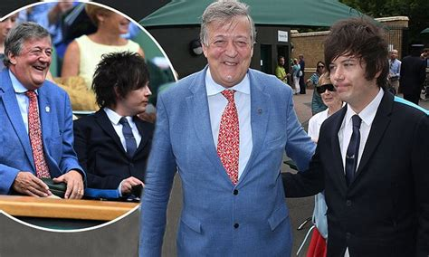 Stephen Fry and husband Elliott, 29, arrive at Wimbledon