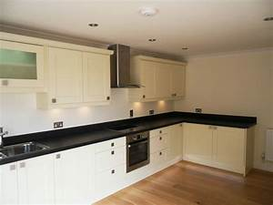 Best wall color for black and white kitchen classic white for Kitchen colors with white cabinets with polka dot wall art