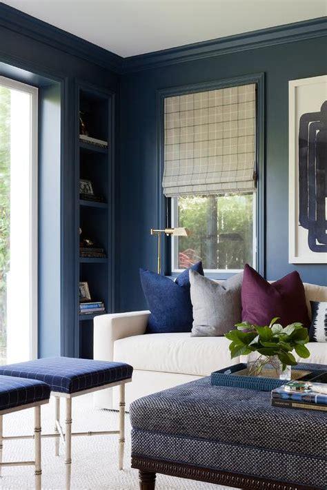 navy blue recessed office shelves transitional den