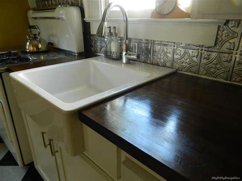 porcelain kitchen sink with backsplash simple kitchen area with white ceramic single bowl apron