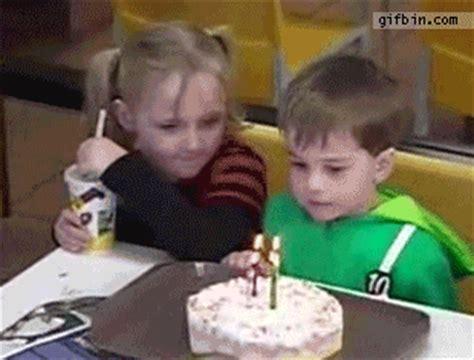 kids sucking  blowing  birthday candles  gifs