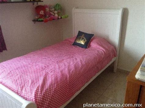 cama individual blanca en leon