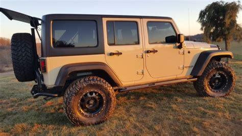 tan jeep lifted sahara tan aev jeep wrangler jk lifted 35 quot tires