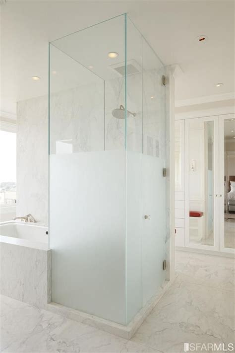 half frosted glass shower wall into her master bath from