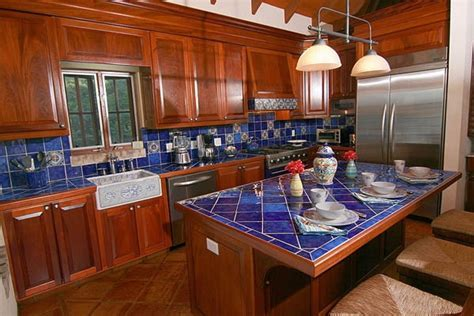 Great combination with the blue tile countertops  and is