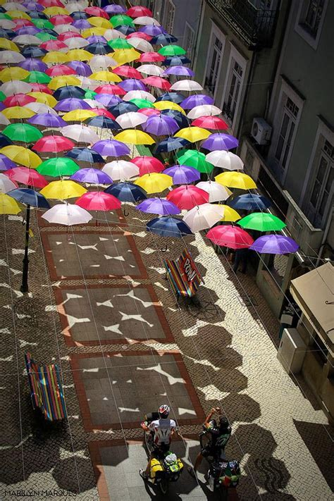 Canopies of Colorful Umbrellas and Beach Balls Cover ...