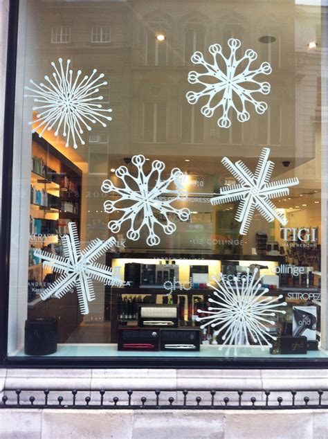 large mdf snowflakes cut   hairdressers window