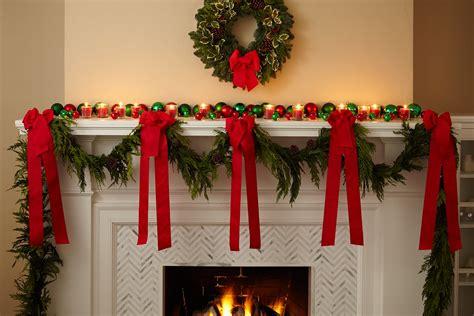 garland strung   fireplace mantel  bright red