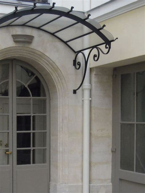 front door overhang brackets arched wrought iron door awning  exterior door awning  media