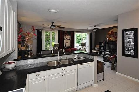 adding cabinets to kitchen best 25 black counters ideas on black 3989
