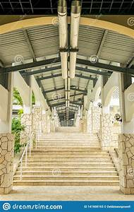 Staircase, Along, Exterior, Hallway, Corridor, With, High, Ceiling, Lights, And, Fixtures, Above, And, Along