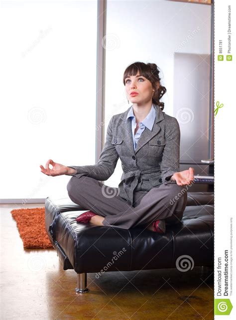 business woman  yoga   modern office stock image