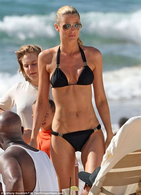 joe mafela bikini paige butcher bonds on the beach with eddie murphy s