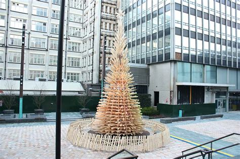 logged netted christmas trees in manchester hello wood redefines the concept of the tree in manchester and budapest