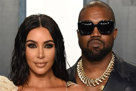 Kim Kardashian smiles for the camera after posing without ...