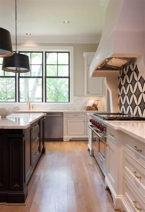 White Kitchen With Black Island And White Marble