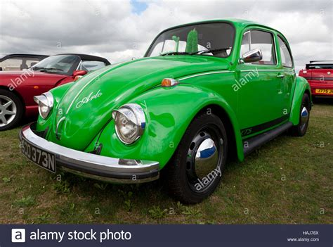 three quarter front view of a green 1974 volkswagen