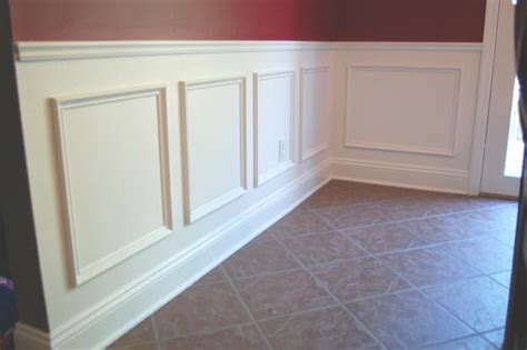 Use Simple Trim To Create A Wainscot By Adding A Chair