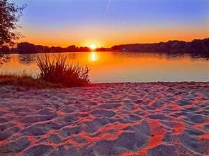 Bilder Am Strand : sonnenaufgang am strand ~ Watch28wear.com Haus und Dekorationen