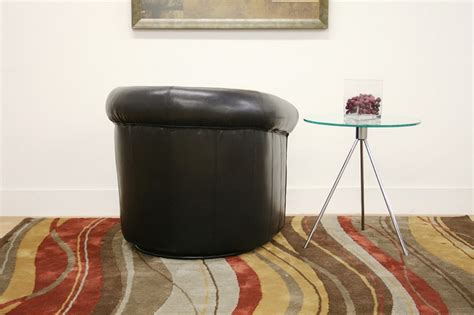 julian black brown faux leather club chair with 360 degree swivel chicago furniture