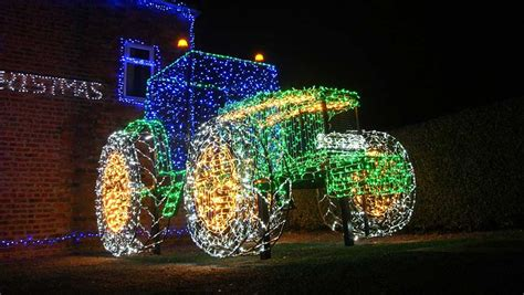 full scale tractor in christmas lights is a hit on social