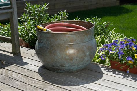 Decorative Garden Hose Pots - hide your hose in a pot willard and may outdoor living