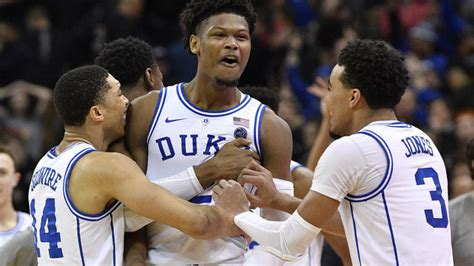 duke  louisville score   blue devils stage epic