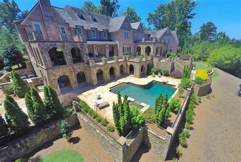 11,000 Square Foot Brick & Stone Lakefront Mansion In