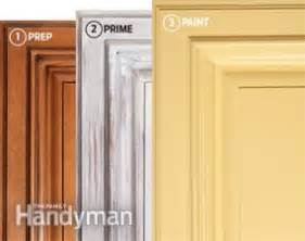 best way to spray paint kitchen cabinets how to spray paint kitchen cabinets the family handyman 9758