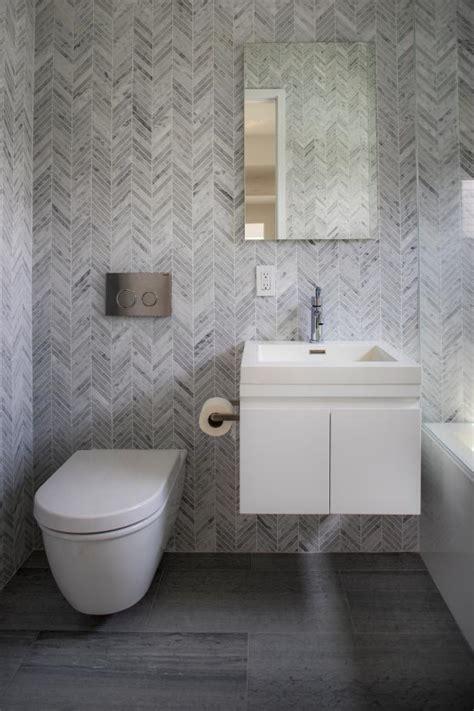 guest bathroom  gray herringbone tile hgtv