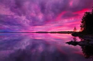 Dramatic Purple Pink Sunset Over Lake In Finland