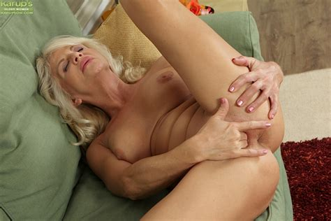 sexy mature blonde iris is lying naked and masturbating her snatch